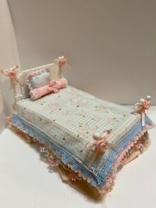 Miniature 1:12 scale dollhouse bed with Floral bedding and pillows.