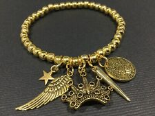 Bijoux GOLD stretch Beaded Bracelet With Wing Crown Star Spike And Coin Charms