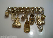 KIRKS FOLLY GOLDTONE BILLION DOLLAR BABY SHOE CHARM PIN