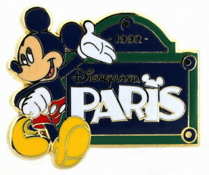 2013 Disney Mickey beside a sign which reads Paris Pin
