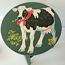Paint-by-Numbers Style Cow Wearing Red Polka Dot Scarf on Blue Wood Stool