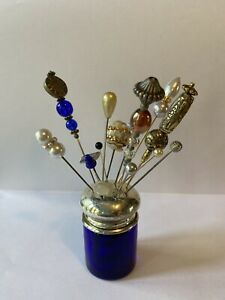 A Collection Of 15 Vintage Hat Pins And Display Stand