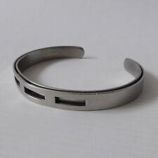 Unisex Modernist stainless steel bracelet. Adjustable tension bangle/cuff, mens