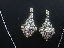 3 cm long 1 1/2 cm wide two ton pure .925 silver earring ( gold over silver ).