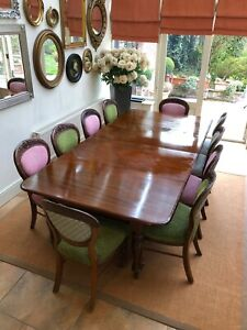 Antique Victorian solid mahogany dining table, with two leaves and eight chairs