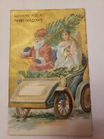 1908 Red Suit SANTA CLAUS In Automobile with Angel Christmas Postcard W14 German