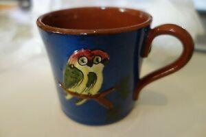 Torquay Devon Ware Motto pottery small coffee or tea cup Parrots design