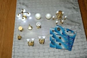 A job lot of battery operated  LED doll's house lights & spare battery's
