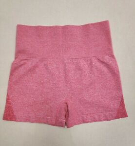 1 Pair of Ladies Gym Shorts. Size XS. Coral with darker tone detail.