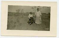Real Photo Postcard - Outside, Man Sitting - Lady Standing - FLEENER Family