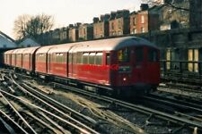 PHOTO  A TRAIN OF 1938 TUBE STOCK LEAVES THE CAR SHEDS AT QUEEN'S PARK ON THE LO