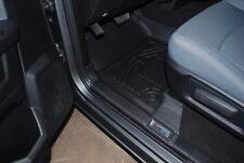 Front & Second Row Black Floor Mats for a 2012 - 2017 Dodge Ram Quad Cab
