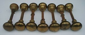 7 PAIRS OF ANTIQUE RECLAIMED BRASS DOOR KNOBS WITH SPINDLES