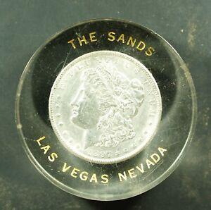 1897 Morgan Dollar Lucite paperweight - The Sands - Las Vegas, Nevada