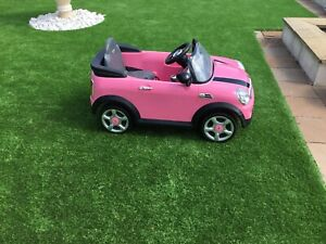 PINK MINI COOPER 6V ELECTRIC CHILDS RIDE ON CAR COMES WITH REMOTE CONTROL.