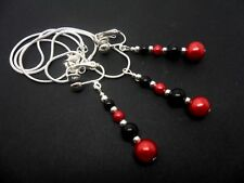 A  BLACK AND RED GLASS PEARL   NECKLACE AND CLIP ON EARRING SET. NEW.