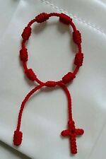 Red Bracelet For Baby Adjustable Protection. With Cross Woven End.