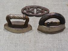 Two Antique Toy Sad Irons and One Trivet