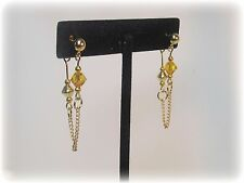 made with Yellow Swarovski Crystal with Chain Earrings loop to back drop Golden