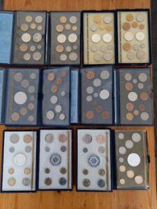 Superbe collection de 12 coffrets FDC complets de 1976 à 1987