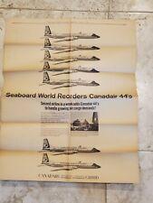 1962 SEABOARD WORLD AIRLINES WALL STREET JOURNAL NEWSPRINT AD CANADAIR CL-44