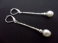 A PAIR OF LOVELY  SILVER PLATED IVORY PEARL DROP LEVERBACK HOOK EARRINGS. NEW.