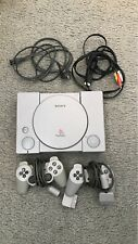 PlayStation 1, 2 controllers, case & games
