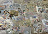 WORLDWIDE STAMP COLLECTION OFF PAPER LOT 50+ COUNTRIES. NO UNITED STATES