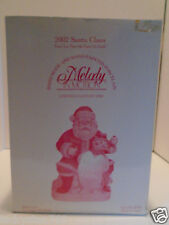 NEW 2002 MELODY IN MOTION CERAMIC MUSICAL SANTA