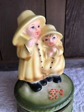 Vintage JAPAN Music Box Boy and Girl with Raincoats Musical Singing In The Rain