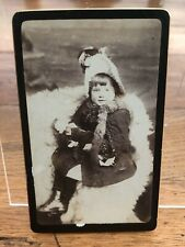 victorian photograph . little girl with her dolly and great hat .