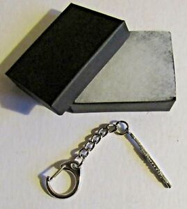 F) KEY-RING PEWTER MUSICAL INSTRUMENT FLUTE REEDLESS WIND BLOW ACROSS OPENING