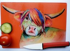 Orange Glass Chopping Board with a HIGHLAND COW  design by artist Maria Moss
