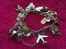 Sterling Silver Charm Braclet with 22 Charms