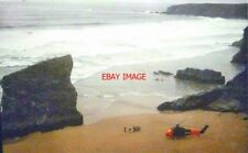 PHOTO  TRENANCE CORNWALL BEACH AT BEDRUTHAN STEPS IN 1977 THE HELICOPTER HAD BEE