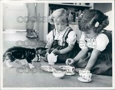 Adorable Toddler Girls Have Tea Party With Cute Kitten Press Photo
