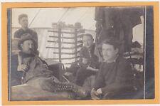 Real Photo Postcard RPPC- Four Men in Tent-Like Structure Rifle Rack Dowagiac MI