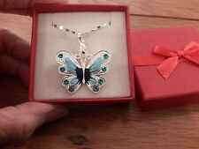 Brand new necklace  with a blue enamel butterfly on an 18in chain  and gift box