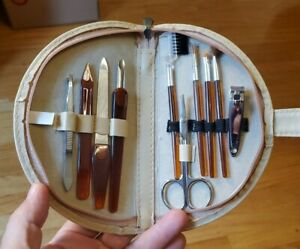 Vintage 10 piece Lady's manicure  grooming kit in toupe colored zippered case