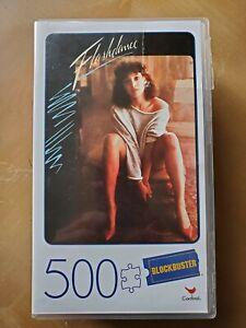 Flashdance 500 Piece Cardinal PuzzleIn Plastic Retro Blockbuster VHS Case-NEW