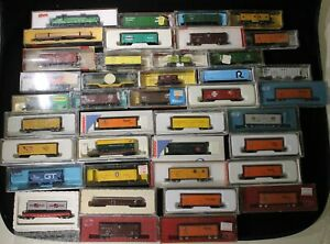 40 Car N-Scale Train Lot - 1 Locomotive, 1 Caboose and 38 various Freight Cars