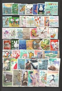 JAPAN LARGE USED RECENT COMMEMORATIVE STAMPS 50 DIFFERENT ON ALBUM PAGE LOT 615