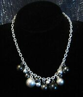 Great Silver tone metal necklace with a great beads in various sizes and shades