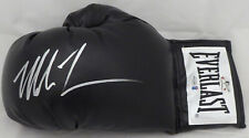 MIKE TYSON AUTOGRAPHED BLACK EVERLAST BOXING GLOVE LH IN SILVER BECKETT 155772