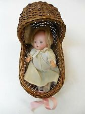 Bisque Head Baby Doll in Wicker Basinet Lot 52