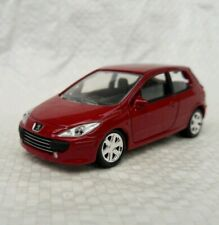 Norev 3 inches chassis métal .  Peugeot 307 rouge .   Neuf en boite. 1/60