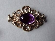 ANTIQUE VICTORIAN 9CT GOLD BROOCH WITH LARGE AMETHYST CABOCHON.