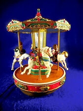 mr. Christmas Go Round carousel  revolves and plays 25 songs. With adapter