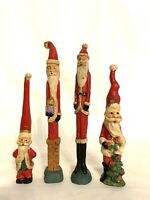 Vtg Set Of 4 Hand Carved Skinny Santas With Lantern Flower Present  7.25-9.75""