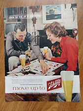1960 Schlitz Beer Ad Couple Playing a Game of Monoply